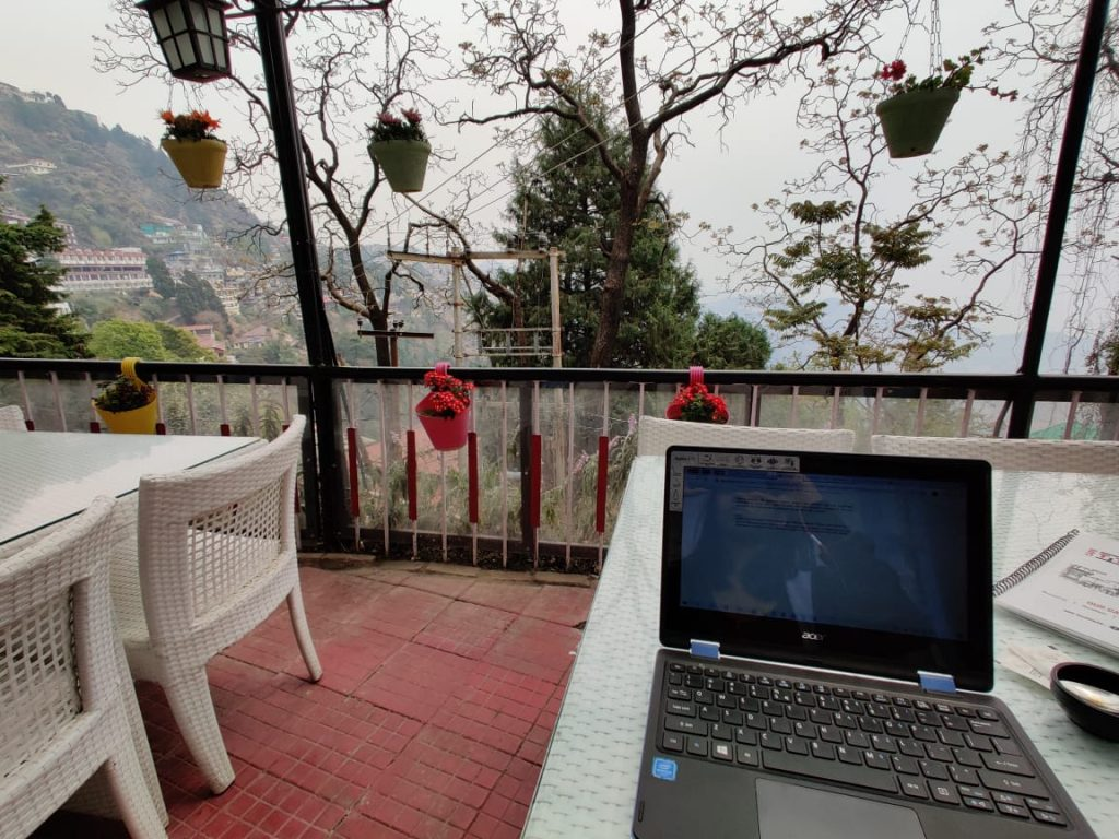 Working from a Cafe in the mountains. Working while traveling.