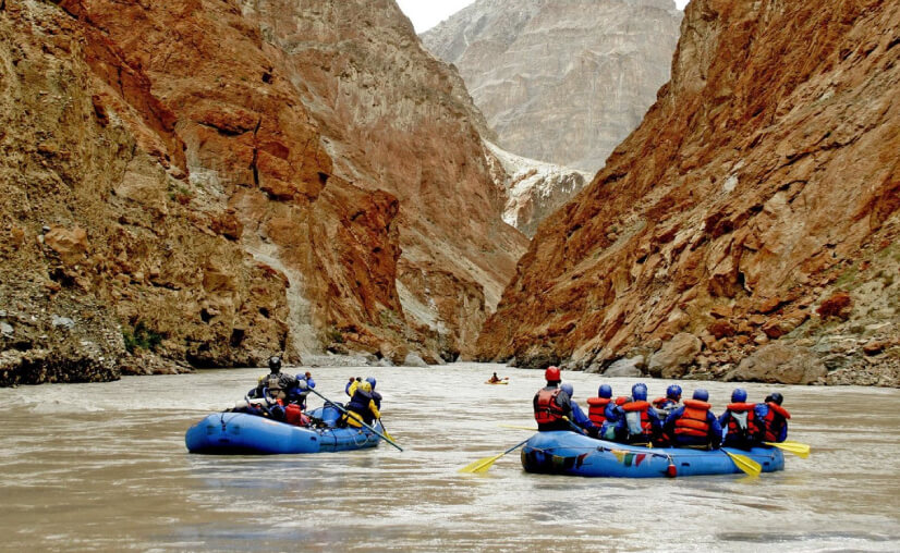 River rafting in Ladakh. High altitude rafting. Rafting among mountains.