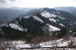 Snow covered hills around Kanatal