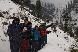Group members enjoying snowfall on trail to Kareri Lake